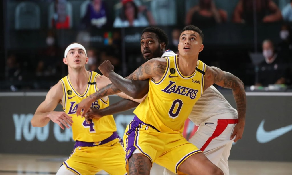 Orlando, FL - JULY 30: Kyle Kuzma #0 of the Los Angeles Lakers and JaMychal Green #4 of the LA Clippers fight for position during a game on July 30, 2020 at The Arena at ESPN Wide World Of Sports Complex in Orlando, Florida. NOTE TO USER: User expressly acknowledges and agrees that, by downloading and/or using this Photograph, user is consenting to the terms and conditions of the Getty Images License Agreement. Mandatory Copyright Notice: Copyright 2020 NBAE