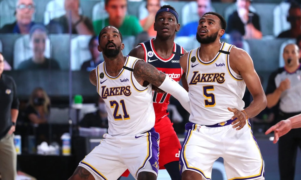 JR Smith #21 and Talen Horton-Tucker #5 of the Los Angeles Lakers plays defense against the Washington Wizards during a scrimmage on July 27, 2020 at Visa Athletic Center at ESPN Wide World Of Sports Complex in Orlando, Florida.