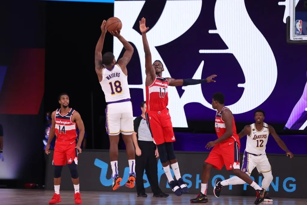 Isaac Bonga #17 of the Washington Wizards plays defense against the Los Angeles Lakers during a scrimmage on July 27, 2020 at Visa Athletic Center at ESPN Wide World Of Sports Complex in Orlando, Florida.