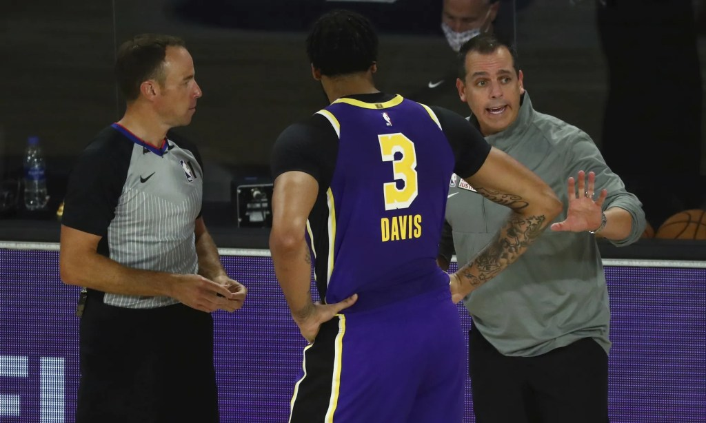 Los Angeles Lakers coach Frank Vogel talks with forward Anthony Davis (3) during the second quarter of the team's NBA basketball game against the Indiana Pacers on Saturday, Aug. 8, 2020, in Lake Buena Vista, Fla.