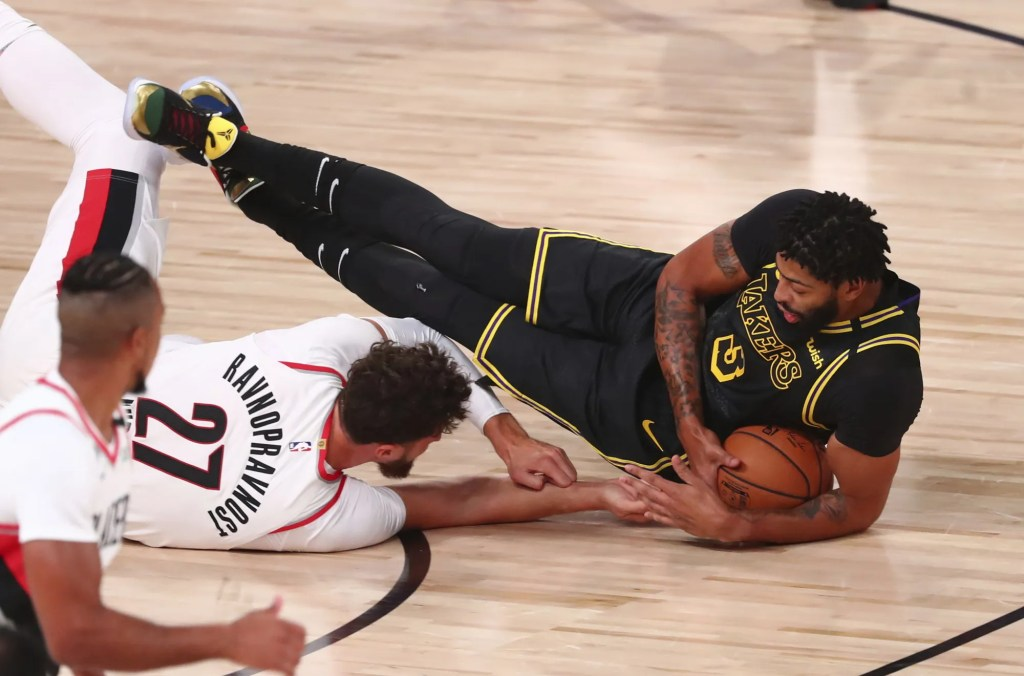 Los Angeles Lakers forward Anthony Davis (3) and Portland Trail Blazers center Jusuf Nurkic (27) go after the ball in the first half of Game 4 of an NBA basketball first-round playoff series, Monday, Aug. 24, 2020, in Lake Buena Vista, Fla.