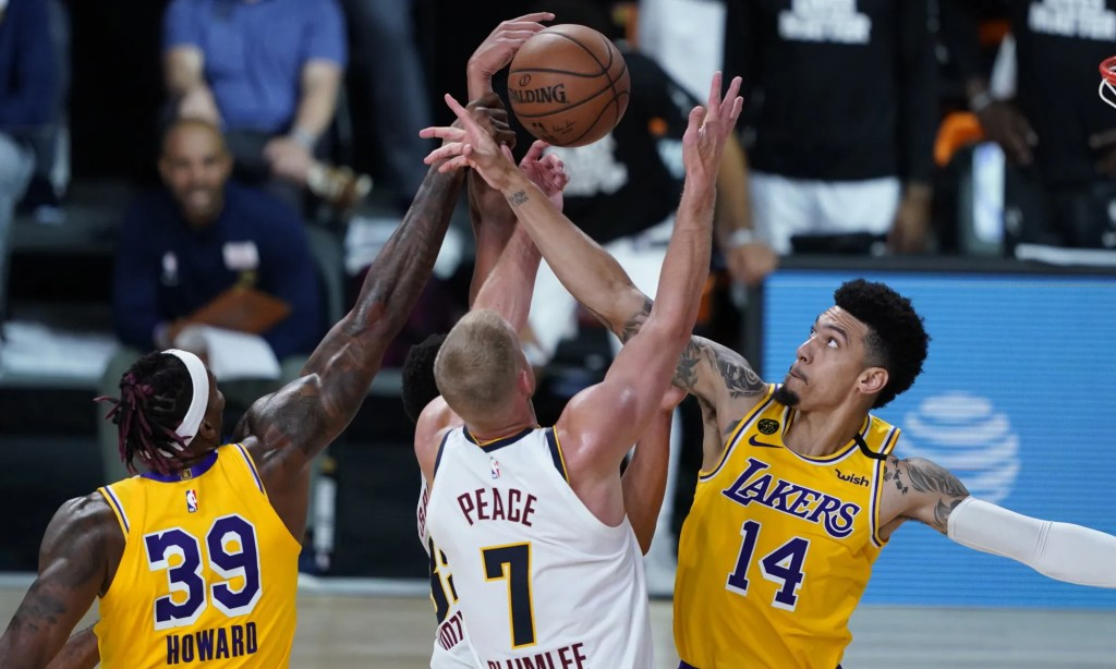 Denver Nuggets' Mason Plumlee (7) battles for the rebound with Los Angeles Lakers' Dwight Howard (39) and Danny Green (14) during the second half of an NBA basketball game Monday, Aug. 10, 2020, in Lake Buena Vista, Fla.