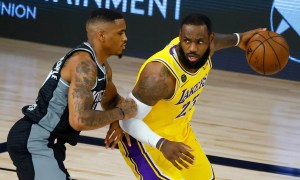 DaQuan Jeffries #19 of the Sacramento Kings defends against LeBron James #23 of the Los Angeles Lakers during the second quarter on August 13, 2020