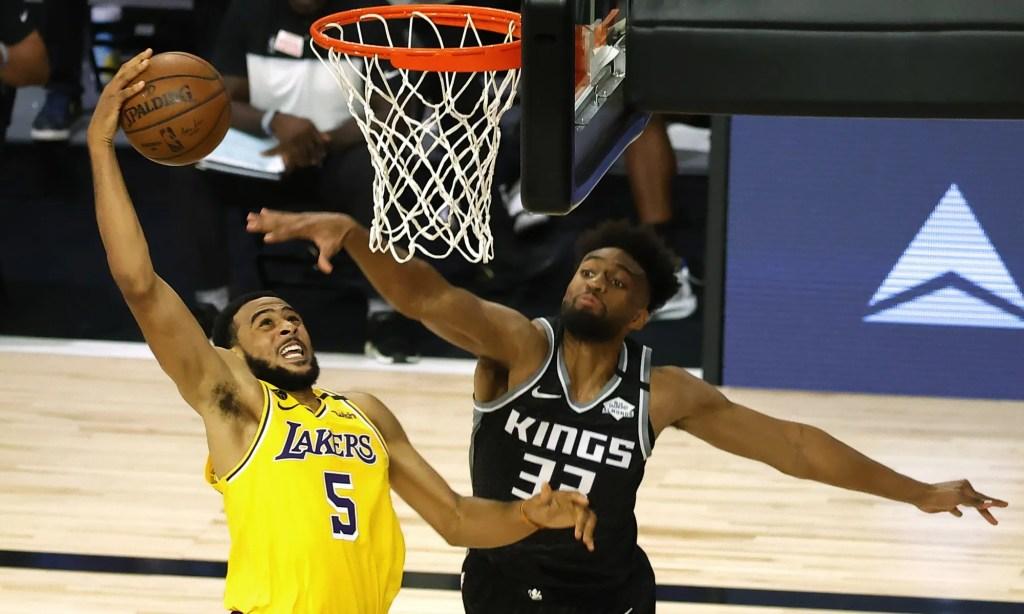 Los Angeles Lakers' Talen Horton-Tucker (5) goes up for a slam dunk against Sacramento Kings' Jabari Parker (33) during the third quarter of an NBA basketball game Thursday, Aug. 13, 2020, in Lake Buena Vista, Fla.