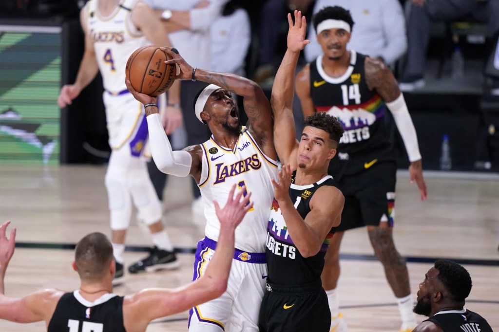 Los Angeles Lakers' Kentavious Caldwell-Pope, center left, goes up for a shot as Denver Nuggets' Michael Porter Jr., right, defends during the first half of Game 3 of the NBA basketball Western Conference final Tuesday, Sept. 22, 2020, in Lake Buena Vista, Fla.