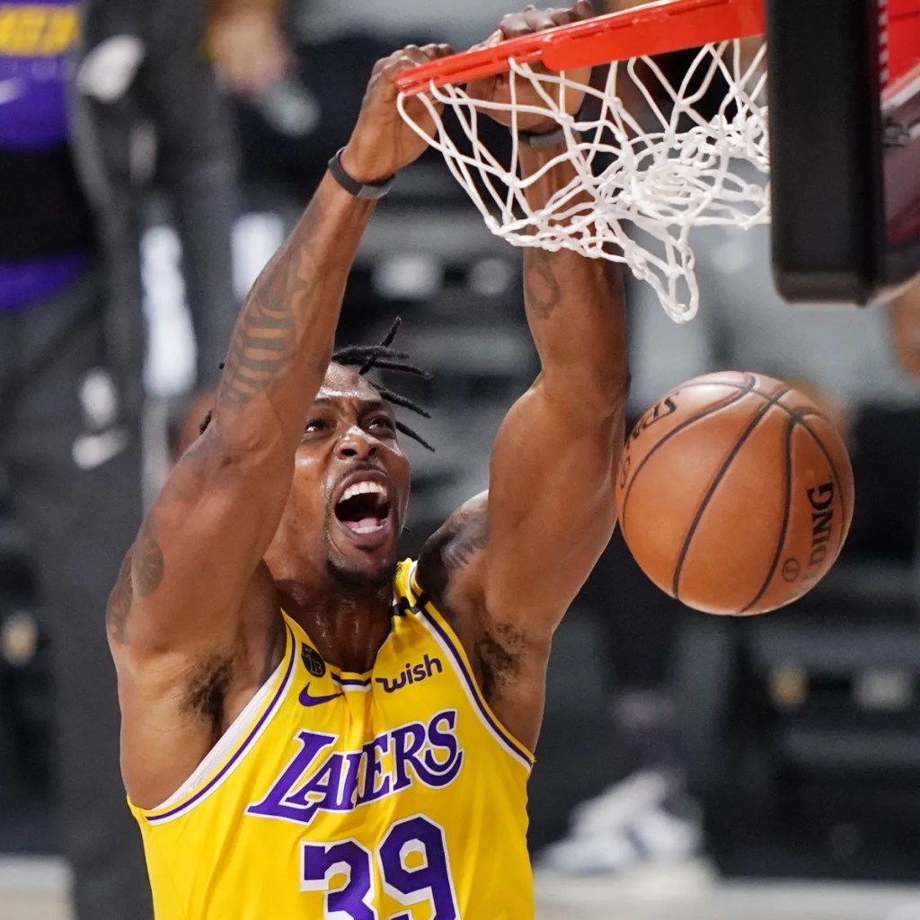 Los Angeles Lakers' Dwight Howard (39) scores against the Denver Nuggets during the first half of an NBA conference final playoff basketball game Thursday, Sept. 24, 2020, in Lake Buena Vista, Fla.