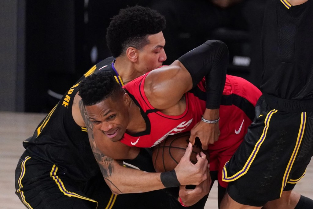 Houston Rockets' Russell Westbrook battles against Los Angeles Lakers' Danny Green, left, during the first half of an NBA conference semifinal playoff basketball game Sunday, Sept. 6, 2020, in Lake Buena Vista, Fla.