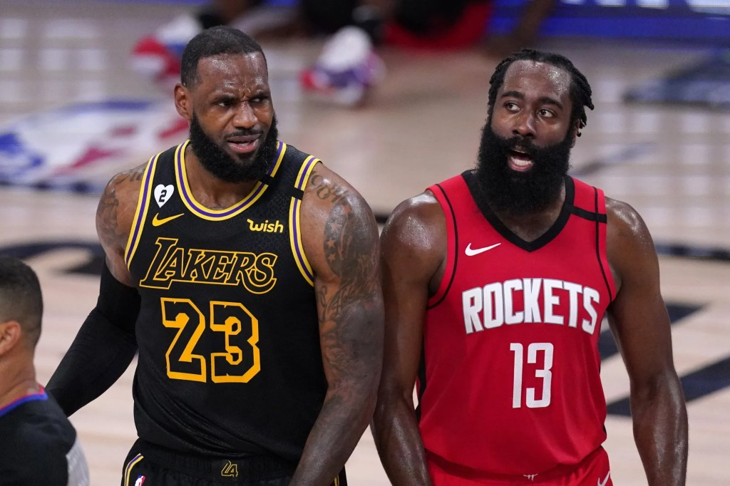 Los Angeles Lakers' LeBron James (23) and Houston Rockets' James Harden (13) react to a call during the second half of an NBA conference semifinal playoff basketball game Sunday, Sept. 6, 2020, in Lake Buena Vista, Fla.