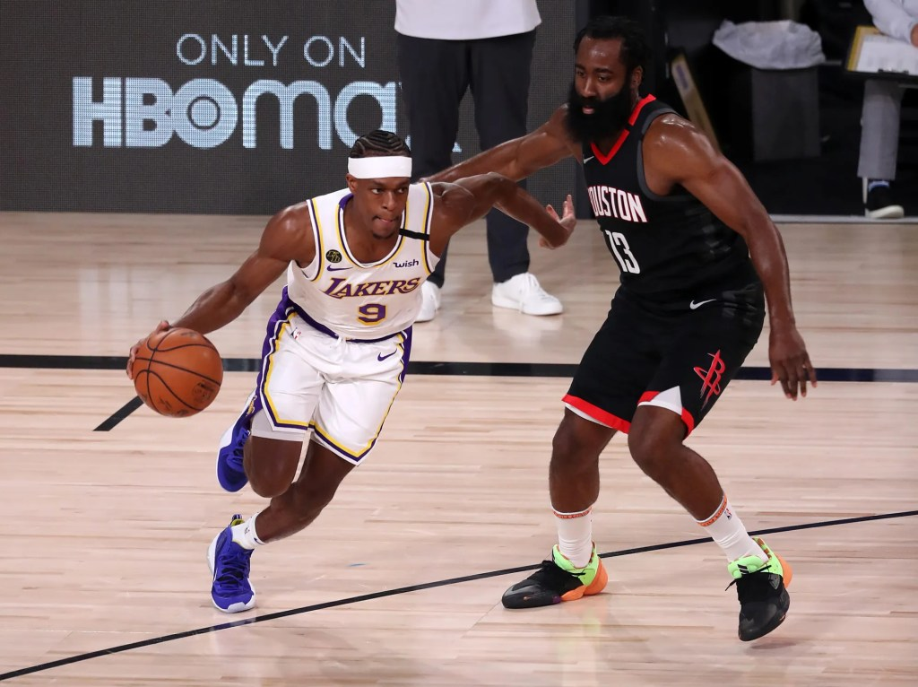 Rajon Rondo #9 of the Los Angeles Lakers drives the ball against James Harden #13 of the Houston Rockets during the first quarter in Game Three of the Western Conference Second Round during the 2020 NBA Playoffs at AdventHealth Arena at the ESPN Wide World Of Sports Complex on September 08, 2020 in Lake Buena Vista, Florida. NOTE TO USER: User expressly acknowledges and agrees that, by downloading and or using this photograph, User is consenting to the terms and conditions of the Getty Images License Agreement.