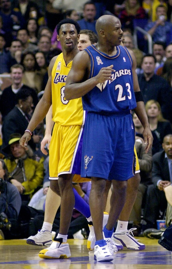 Los Angeles Lakers' Kobe Bryant, left, looks over at Washington Wizards' Michael Jordan during the second half, Tuesday night, Feb. 12, 2002, in Los Angeles. The Lakers won 103-94.