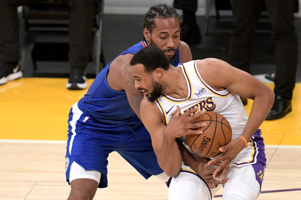 Los Angeles Lakers guard Talen Horton-Tucker, front steals the ball from Los Angeles Clippers forward Kawhi Leonard during the first half of an NBA preseason basketball game in Los Angeles, Sunday, Dec. 13, 2020. (AP Photo, Kyusung Gong)