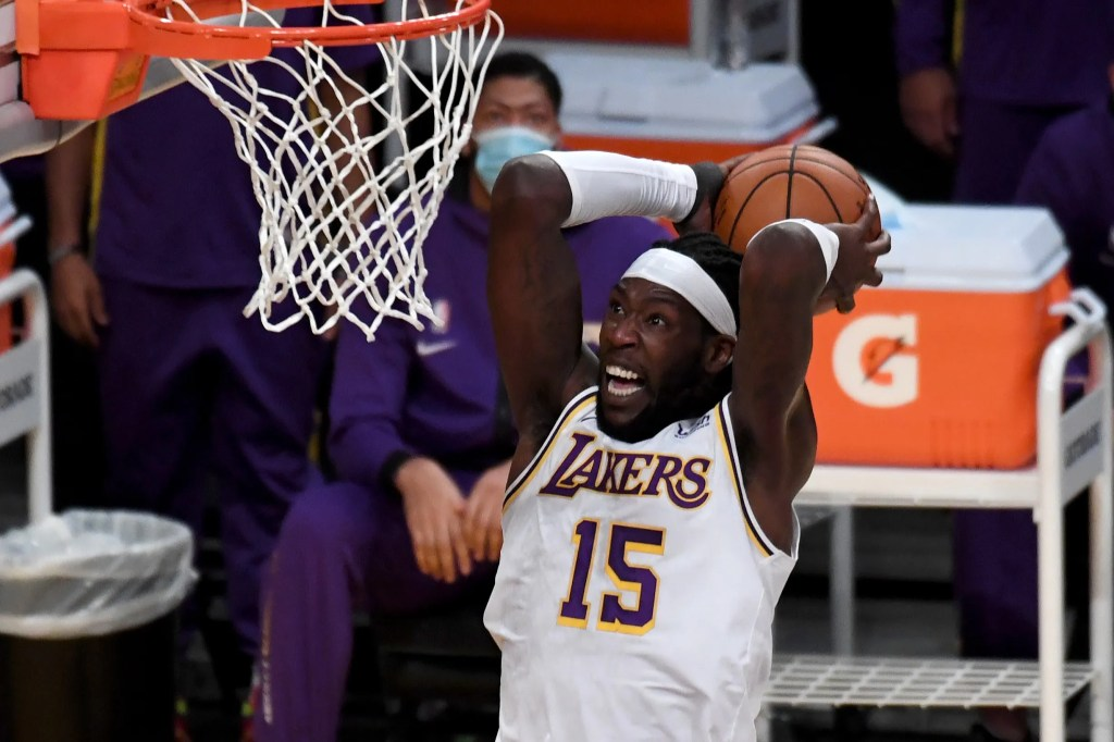 The Lakers' Montrezl Harrell #15 dunks the ball during their NBA preseason game against the Clippers at the Staples Center in Los Angeles, Friday, December 11, 2020.