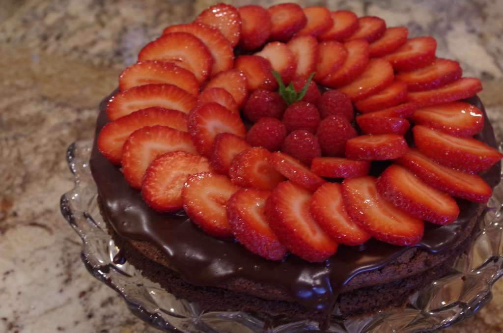 gluten free flourless chocolate torte - Decadent rich chocolate cake. Serve it with berries and whip cream. Worth the spurge! | www.lakesidetable.com