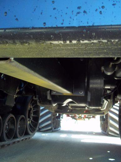 brace from bracket to axle
