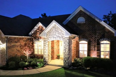 Stunning exterior w/bright evening lighting