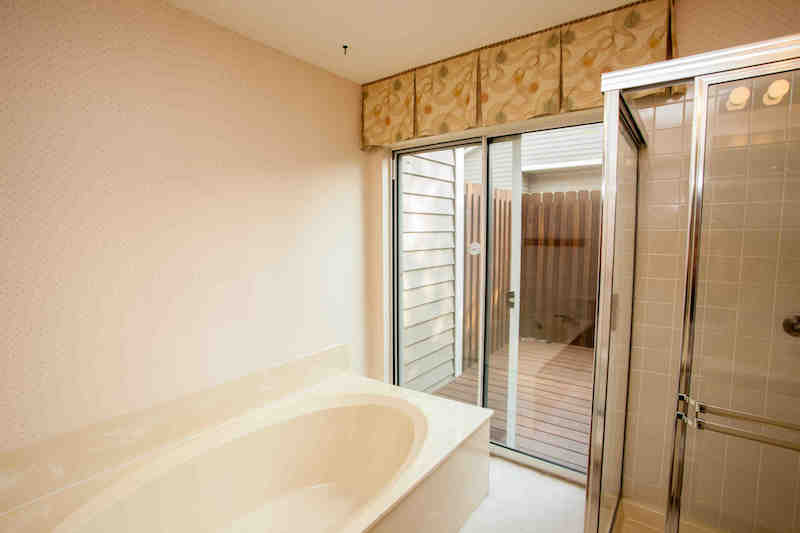 Master bath w/separate tub & shower has access to private deck
