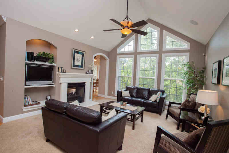Gorgeous vaulted great room w/wall of windows & fireplace