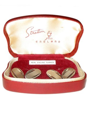 Gilt engine turned cufflinks by Stratton in their original box.