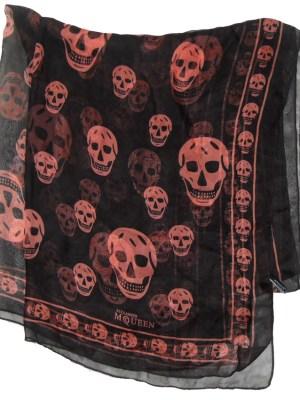 Long skull design scarf by Alexander McQueen, orange on black