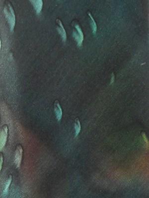 Vintage Moschino silk tie with a dark green background