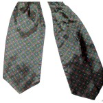 Dark green background with a blue, orange and white design Duggie cravat