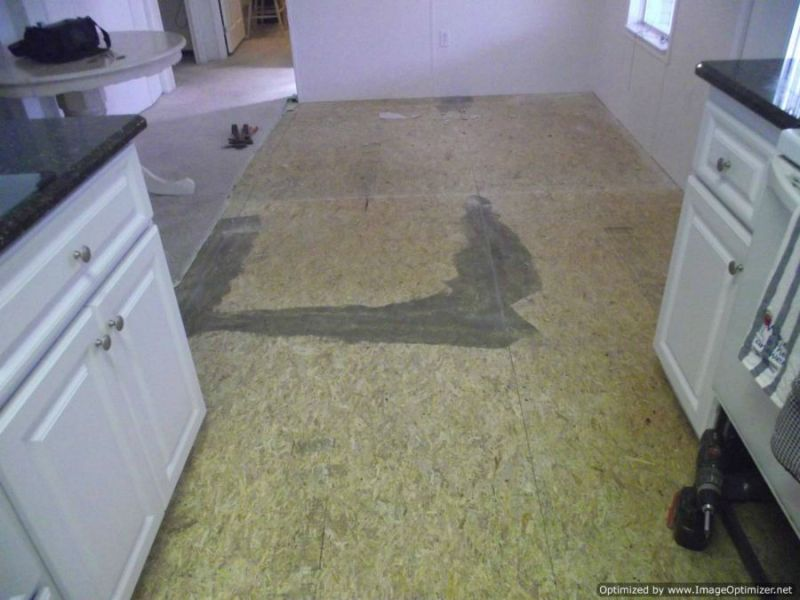 Nirvana Plus Laminate Review Before photo of Nirvana V groove laminate flooring installation  removing  old vinyl down to