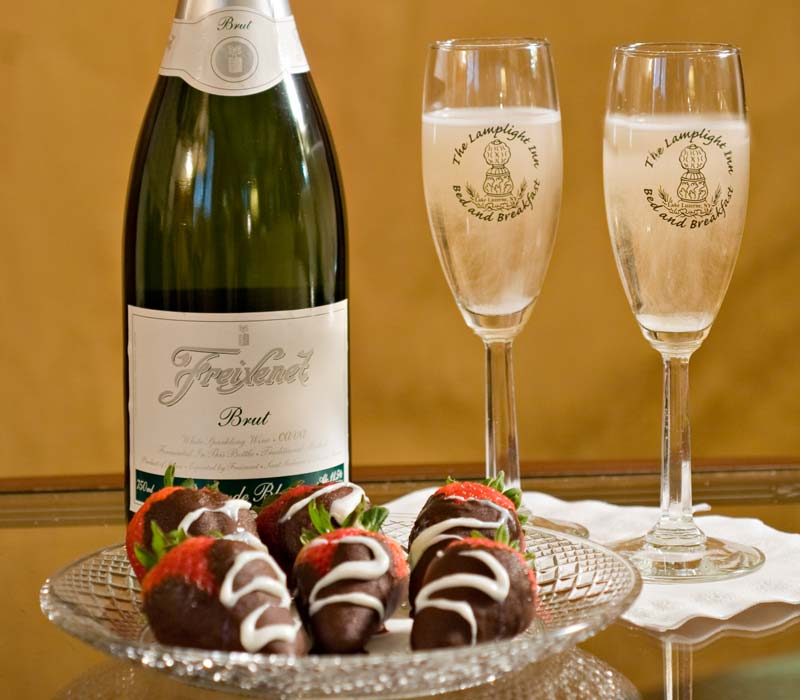 Chocolate covered strawberries and a bottle of champagne