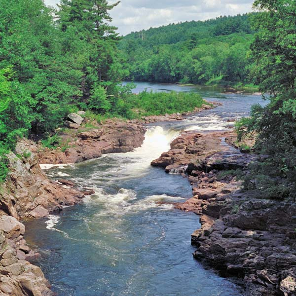 River flowing through Forest in Lake Lucerne in Adirondacks New York