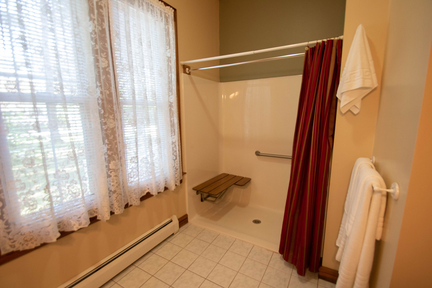 Bathroom with shower with bench