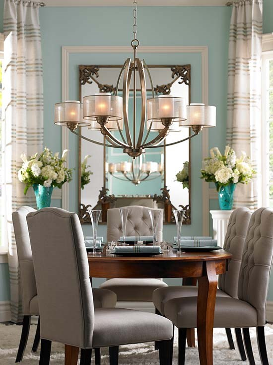 A Chandelier Hangs Over Dining Room Table