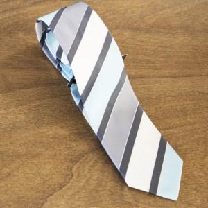 Cravatta a righe fondo celeste mod. 293