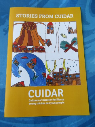 A leaflet of 'Stories from CUIDAR' in white on an orange background with the CUIDAR project logo pictures in the middle - (clockwise from the top left) volcano, earthquake, storm and wave. The CUIDAR logo text is in white below.