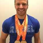 Roman Soboliev, jiu jitsu athlete, with his gold medals