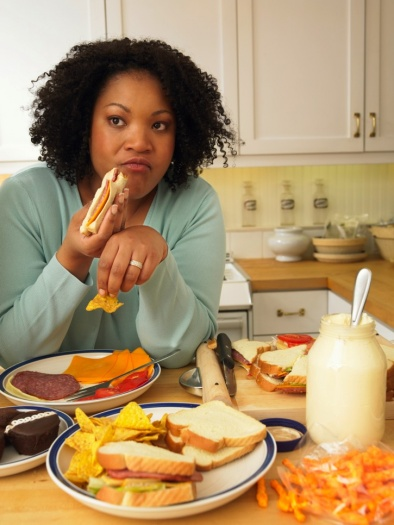 woman-eating-junk-food-in-kitchen