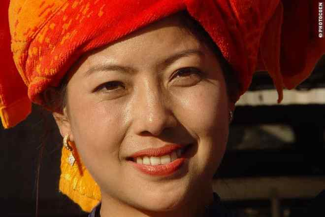 Woman in Myanmar ready to pose for a photo