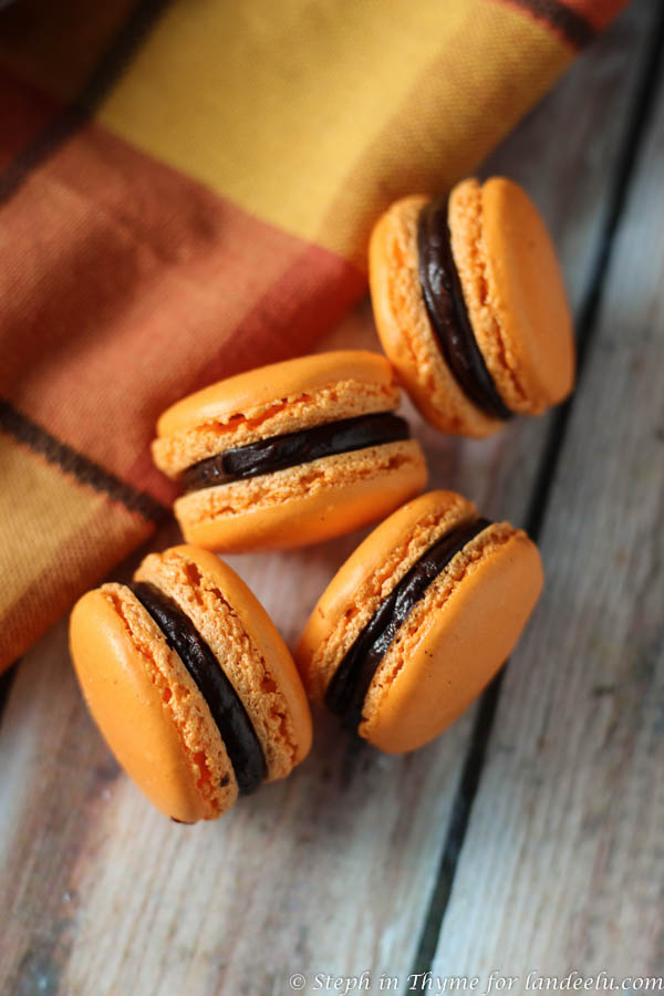 Halloween macarons paired with a seasonal colored linen