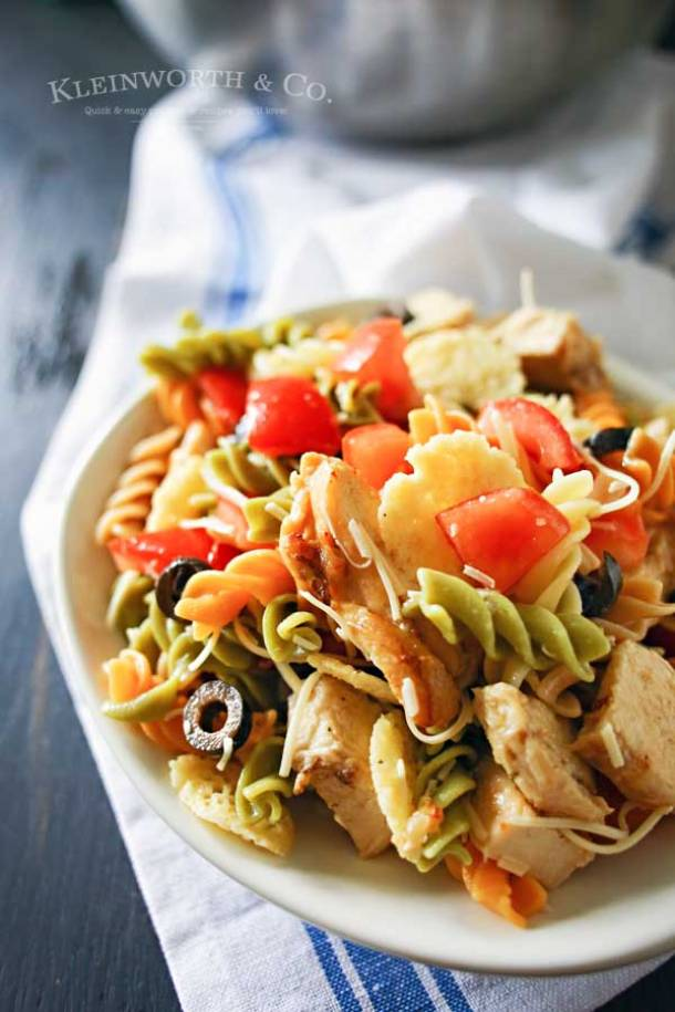 Pasta Salad Recipe - Italian Pasta Salad with Grilled Chicken and Parmesan Chips - So yummy and perfect for potlucks and BBQs! Recipe via Kleinworth and Co