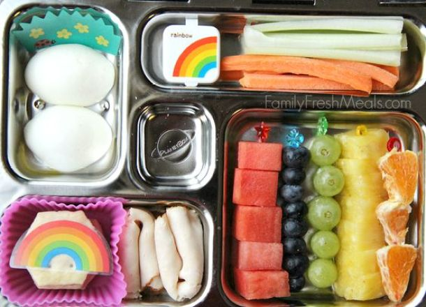 Celery, carrots and a small container of dip, hard boiled eggs, some lunch meat and crackers and fresh fruit - all in a fun PlanetBox lunchbox via Family Fresh Meals