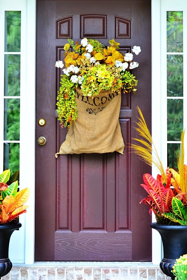 DIY projects - Fall Wreaths - Fall front door floral arrangement idea in a burlap sack via At the Picket Fence