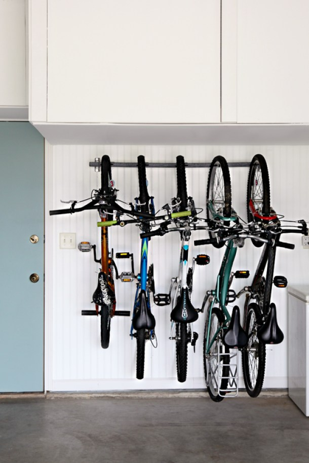 Hanging up the bicycles takes up SO much less space! | i heart organizing