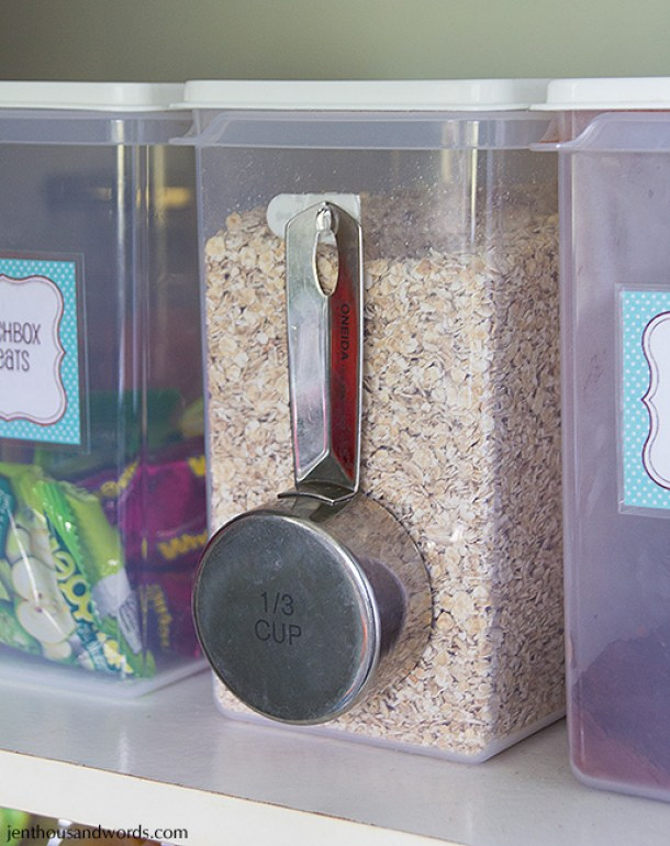 Hang your measuring cup on the side of the flour, sugar and cereal canisters with a little command hook! What a great idea via Jen Thousand Words