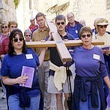 Holy Land pilgrimage: Carrying cross to Calvary on Via Dolorosa Jerusalem