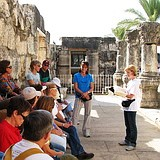 Holy Land pilgrimage: Bible teaching in ancient Capernaum synagogue at Sea of Galilee