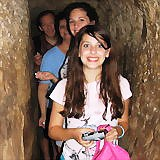 Walking through Hezekiah's water tunnel at the City of David, Jerusalem