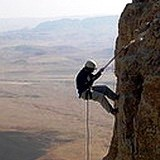 Cliff rappelling at Makhtesh Ramon Crater in Negev desert, Israel