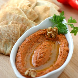A classic recipe for Muhammara, a roasted red pepper spread with a spicy, sweet, tangy, garlicky, and smoky flavor.