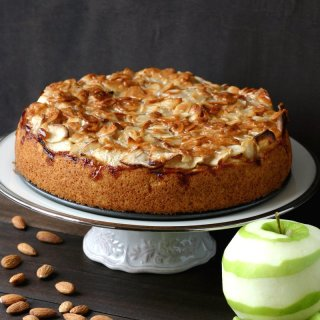 A vegan version of the classic German Apple Cake featuring a layer of moist cake topped with tart apples and smothered with sweet, toasted almonds.