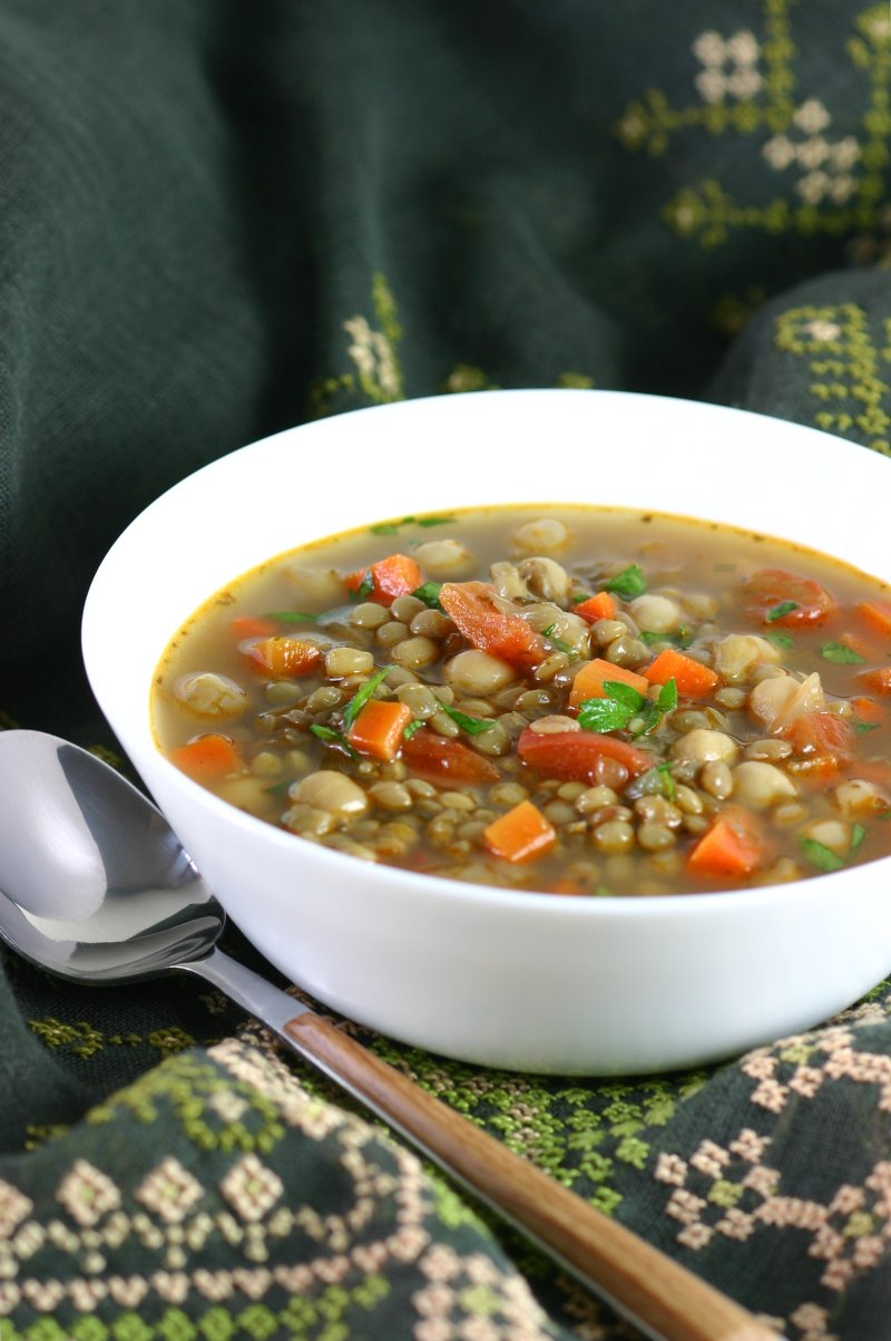 This Middle Eastern Green Lentil Soup features tender lentils, hearty chickpeas, and a spiced broth. Serve it as is or stir in some chopped greens.