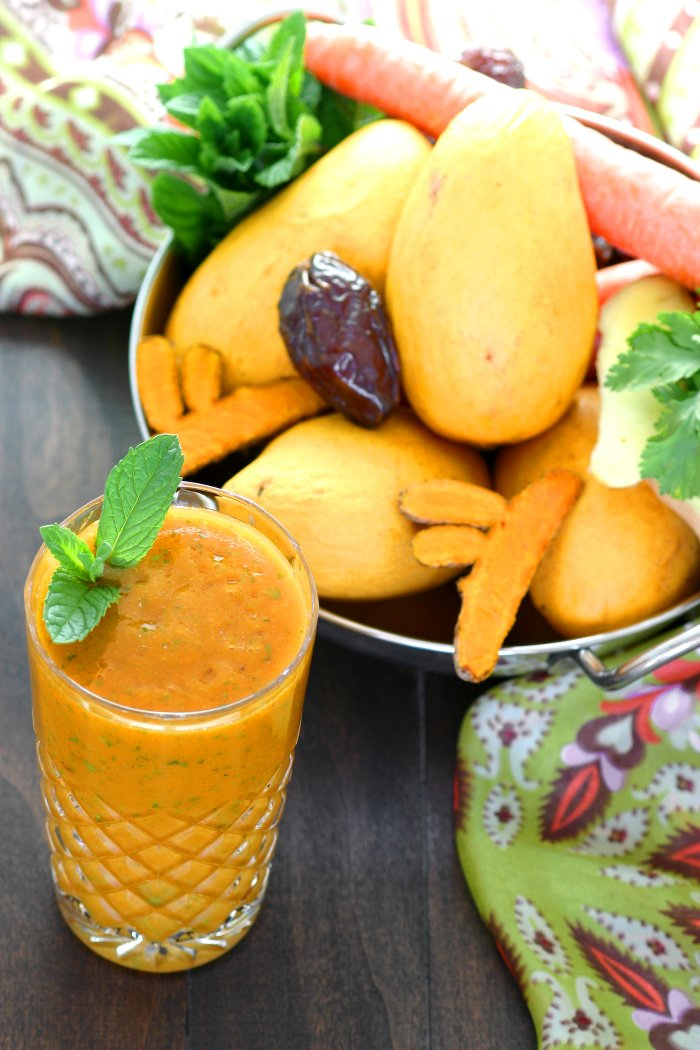 Mangos, carrots, and fresh turmeric combine with refreshing herbs to create this brilliantly-hued Mumbai Smoothie.