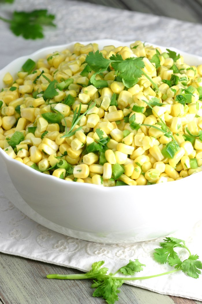 Sweet, tart, and herbaceous, this recipe for Raw Corn Salad will soon be one of your favorite ways to use fresh summer corn!